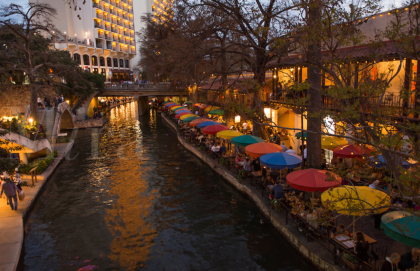 San Antonio Texas famous The Riverwalk at night with boats and restaurants with colorful umbrellas and tourists
