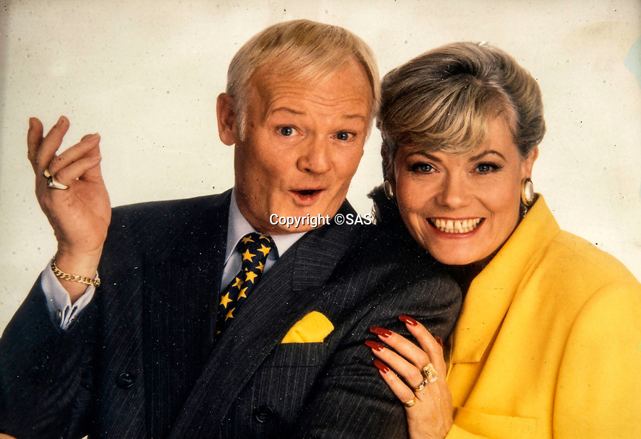 BNPS.co.uk (01202 558833)<br /> Pic:  SAS/BNPS<br /> <br /> John with Are You Being Served co-star Wendy Richards.<br /> <br /> Not Free! - 'King of Camp' John Inman's archive to be auctioned.<br /> <br /> Possessions from the estate of the late TV star John Inman have emerged for sale.<br /> <br /> The actor graced the small screen in the hit BBC comedy 'Are You Being Served' for 13 years from 1972 to 1985.<br /> <br /> The auction includes mementos from the sitcom which attracted 22 million viewers at its peak and spawned a film.