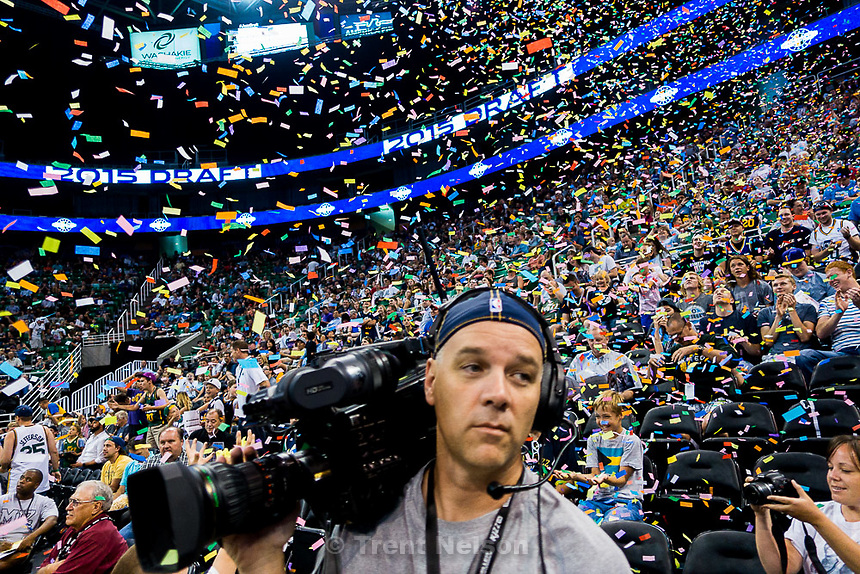 Trent Nelson  |  The Salt Lake Tribune<br /> tv cameraman in foreground as fans react as the Utah Jazz select Kentucky forward Trey Lyles with the 12th pick in the 2015 NBA Draft. Jazz fans were invited to EnergySolutions Arena in Salt Lake City, Thursday June 25, 2015 to watch a broadcast of the draft.
