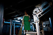 Factory worker, Indrey Sarki at the drying machine at Makaibari Tea Estate factory, Kurseong in Darjeeling, India.