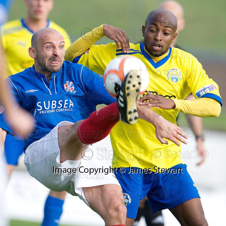 Cowdenbeath's Colin Cameron clears from Morton's Fouad Bachirou ...