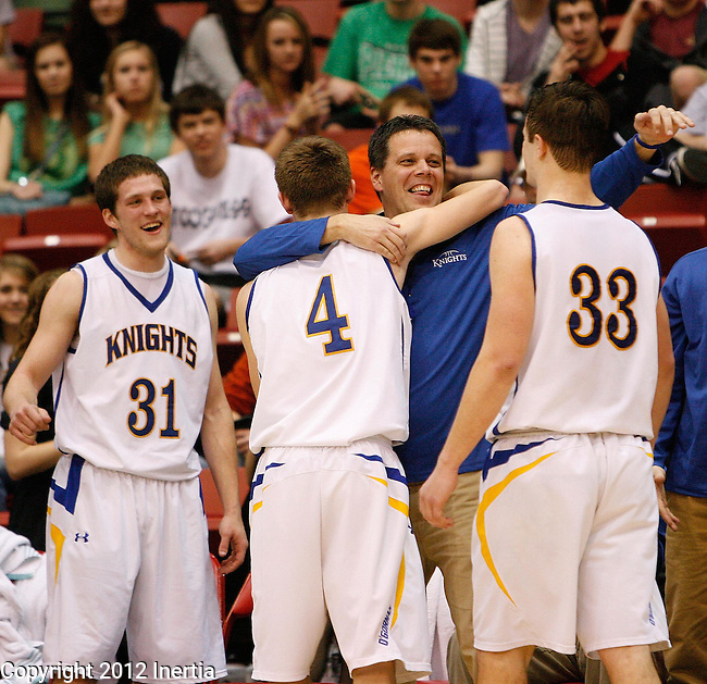 RAPID CITY, S.D. -- Sioux Falls O'Gorman head boys basketball coach Derek Robey hugs his players during final substitution in the final seconds during their championship game against Mitchell at the 2012 South Dakota State AA Boys Basketball Tournament in Rapid City, S.D. Saturday (Photo by Dick Carlson/Inertia)