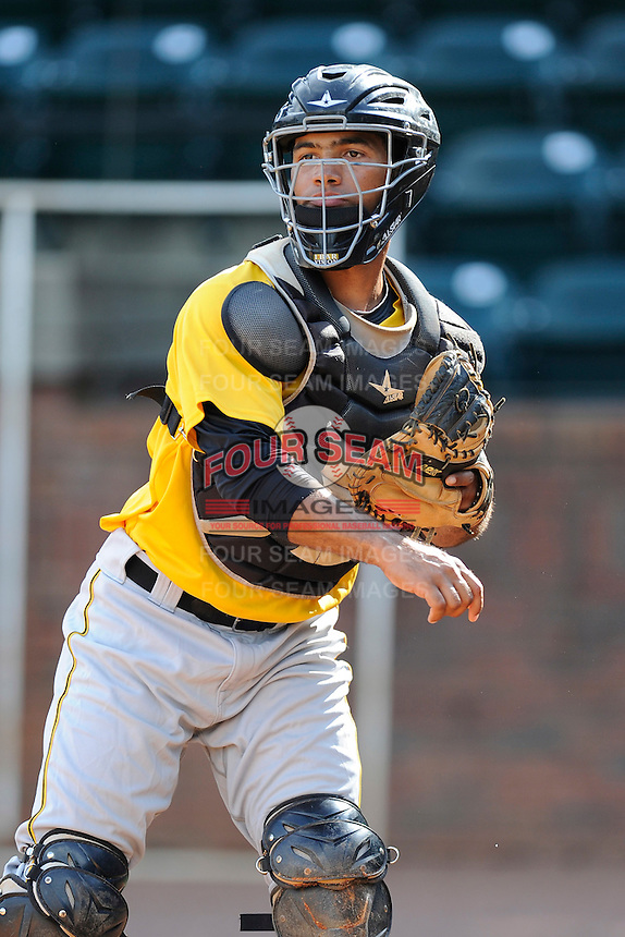 Catcher Tomas Morales (54) of the Bristol Pirates warms up before a game against the Greeneville Astros on Friday, July 25, 2014, at Pioneer Park in Greeneville, Tennessee. Greeneville won, 9-4. (Tom Priddy/Four Seam Images)