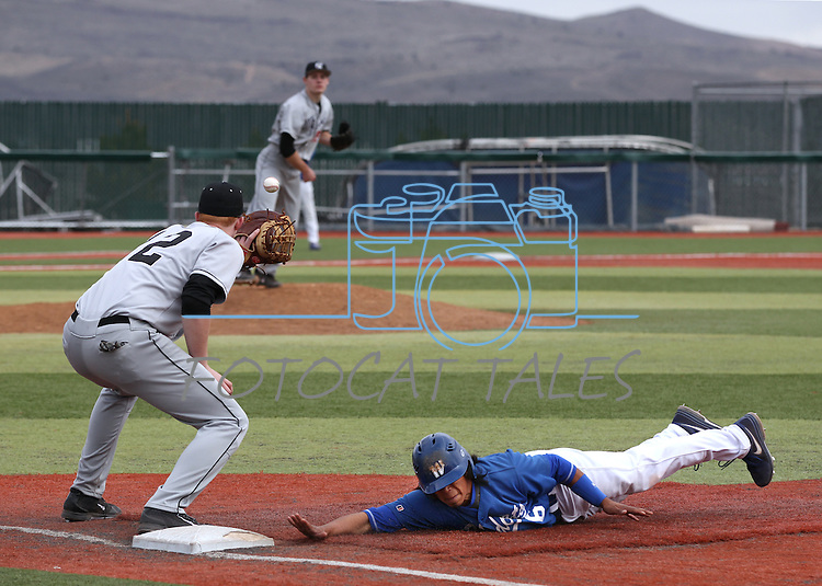 Western Nevada College's Tony Roque dives back safely under the Mt. Hood pick-off attempt at John L. Harvey Field in Carson City, Nev., on Friday, March 14, 2014. <br /> Photo by Cathleen Allison/Nevada Photo Source