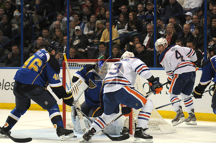 From left, St. Louis Blues defenseman Roman Polak (46), St. Louis Blues goalie Jake Allen (34), Edmonton Oilers center Ryan Nugent-Hopkins (93), and Edmonton Oilers left wing Taylor Hall (4) scurry around near the front of the Blues goal in second period action during a game between the Edmonton Oilers and the St. Louis Blues on Tuesday March 26, 2013 at the Scottrade Center in downtown St. Louis.