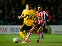 Lincoln City's Kellan Gordon vies for possession with Wolverhampton Wanderers U21's Cameron John<br /> <br /> Photographer Chris Vaughan/CameraSport<br /> <br /> The EFL Checkatrade Trophy Northern Group H - Lincoln City v Wolverhampton Wanderers U21 - Tuesday 6th November 2018 - Sincil Bank - Lincoln<br />  <br /> World Copyright © 2018 CameraSport. All rights reserved. 43 Linden Ave. Countesthorpe. Leicester. England. LE8 5PG - Tel: +44 (0) 116 277 4147 - admin@camerasport.com - www.camerasport.com