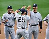 Baltimore, MD - April 6, 2009 -- New York Yankee first baseman Mark Teixeira (25) slaps hands with members of the pitching staff including Andy Pettitte as hes is introduced on Opening Day against the Baltimore Orioles at Oriole Park at Camden Yards in Baltimore, MD on Monday, April 6, 2009..Credit: Ron Sachs / CNP.(RESTRICTION: NO New York or New Jersey Newspapers or newspapers within a 75 mile radius of New York City)