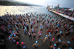 KONA, HI - OCTOBER 8:   Athletes prepare to enter the water during 2011 Ford Ironman World Championship on October 8, 2011 in Kona, Hawaii. (Photo by Donald Miralle) *** Local Caption ***