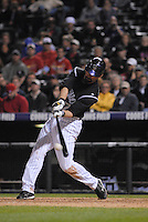 Colorado Rockies 1st baseman Todd Helton hits a double against the St. Louis Cardinals. The Cardinals defeated the Rockies 6-5 at Coors Field in Denver, Colorado on May 6, 2008.