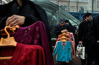 Crowds walk through a bustling market area in the Uighur neighborhood of Urumqi, Xinjiang, China. The city is divided between Han and Uighur ethnic groups and in 2009 saw violent clashes between the groups.