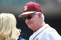 Florida State Seminoles head coach Mike Martin smiles while being interviewed by Lyndsay Rowley between innings of the game against the Duke Blue Devils in the first semifinal of the 2017 ACC Baseball Championship at Louisville Slugger Field on May 27, 2017 in Louisville, Kentucky.  The Seminoles defeated the Blue Devils 5-1.  (Brian Westerholt/Four Seam Images)