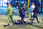 © Joel Goodman - 07973 332324 . 07/04/2017 . Manchester , UK . 10th in a sequence . Five youths on one as a fight breaks out in which a man's head is kicked and stamped upon , in Piccadilly Gardens . Greater Manchester Police have authorised dispersal powers and say they will ban people from the city centre for 48 hours , this evening (7th April 2017) , in order to tackle alcohol and spice abuse . Photo credit : Joel Goodman