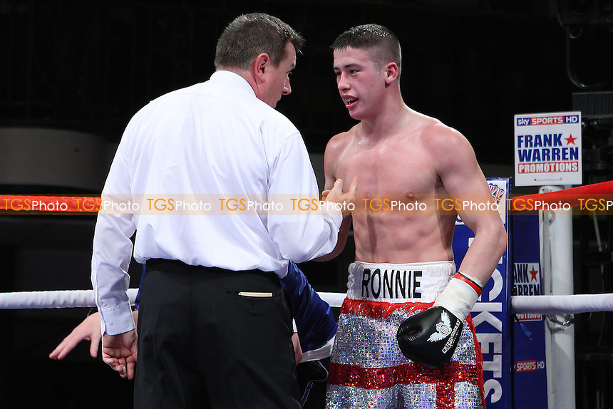 Ronnie Heffron (silver/red shorts) defeats Kevin McCauley in a Welterweight boxing contest  at York Hall, Bethnal Green, London, promoted by Frank Warren - 19/02/11 - MANDATORY CREDIT: Gavin Ellis/TGSPHOTO - Self billing applies where appropriate - Tel: 0845 094 6026