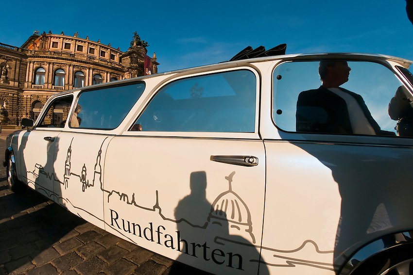 A Trabi limousine with the Semper Opera House in background, Dresden, Saxony, Germany