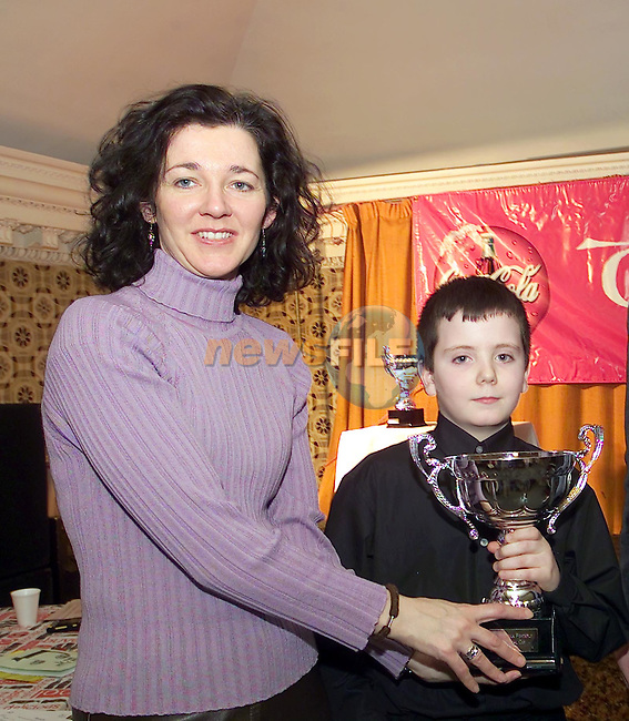 Siobhan Woods from drogheda concentrates presents Evan Kelly (Kells with his trophy from the Tocatta House Music Compatitions held in the Sound Shop in Drogheda...Picture Fran Caffrey Newsfile.Supply Pic..This Picture is sent to you by:..Newsfile Ltd.The View, Millmount Abbey, Drogheda, Co Louth, Ireland..Tel: +353419871240.Fax: +353419871260.GSM: +353862500958.ISDN: +353419871010.email: pictures@newsfile.ie.www.newsfile.ie