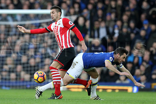 02.01.2017. Goodison Park, Liverpool, England. EPL Premier league football, Everton versus Southampton. Leighton Baines of Everton is sent flying by a strong challenge from Dusan Tadic of Southampton.