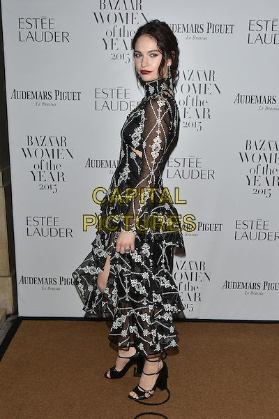 Lily James<br /> Harper's Bazaar Women of the Year 2015 awards,  Claridges Hotel n London, November 03, 2015.<br /> CAP/PL<br /> &copy;Phil Loftus/Capital Pictures