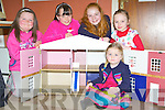 Little Rebecca O'Leary checks to see if she can fit into the handcrafted Georgian dolls house that the Kilcummin Looking Good committee have as first prize in their Christamas raffle watched by l-r: Caoimhe Lehane, Shauna O'Donoghue, Shauna O'Leary, and Rachel Fleming