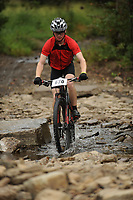 NWA Democrat-Gazette/ANDY SHUPE<br /> Brandon Campbell of Fort Smith rides across Lee Creek Saturday, Sept. 19, 2015, during the Northwest Arkansas Mountain Bike Championships at Devil's Den State park.