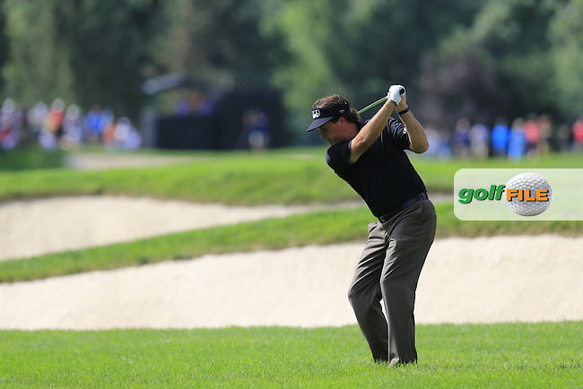 Phil Mickelson (USA) plays his 2nd shot on the 14th hole during Friday's Round 1 of the 2013 Bridgestone Invitational WGC tournament held at the Firestone Country Club, Akron, Ohio. 2nd August 2013.<br /> Picture: Eoin Clarke www.golffile.ie
