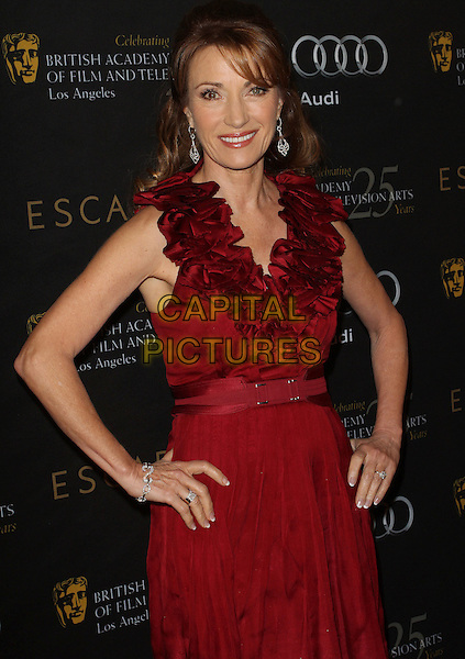 Jane Seymour.18th Annual BAFTA Los Angeles Awards Season Tea Party held at the Four Seasons Hotel, Beverly Hills, California, USA..January 14th, 2012.half length red ruffle neckline hands on hip dress  .CAP/ADM/KB.©Kevan Brooks/AdMedia/Capital Pictures.