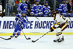 SIOUX FALLS, SD - MARCH 24: Trevor Stone #9 from Air Force controls the puck against Jared Thomas #22 for Minnesota Duluth during their game at the 2018 West Region Men's NCAA DI Hockey Tournament at the Denny Sanford Premier Center in Sioux Falls, SD. (Photo by Dave Eggen/Inertia)