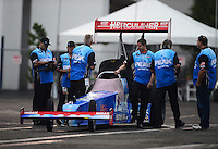 Nov. 8, 2012; Pomona, CA, USA: NHRA crew members for top fuel dragster driver T.J. Zizzo push his dragster back to the pits when it starts to rain during qualifying for the Auto Club Finals at at Auto Club Raceway at Pomona. Mandatory Credit: Mark J. Rebilas-