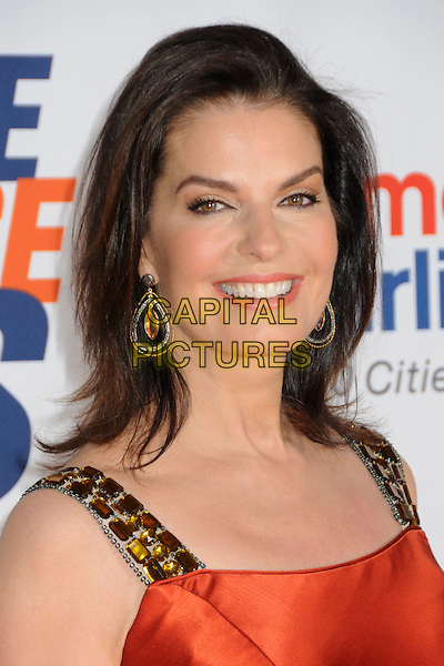 SELA WARD.18th Annual Race To Erase MS held at the Hyatt Regency Century Plaza Hotel, Century City, California, USA..April 29th, 2011.headshot portrait gold stones embellished jewel encrusted earrings smiling red silk satin  .CAP/ADM/BP.©Byron Purvis/AdMedia/Capital Pictures.