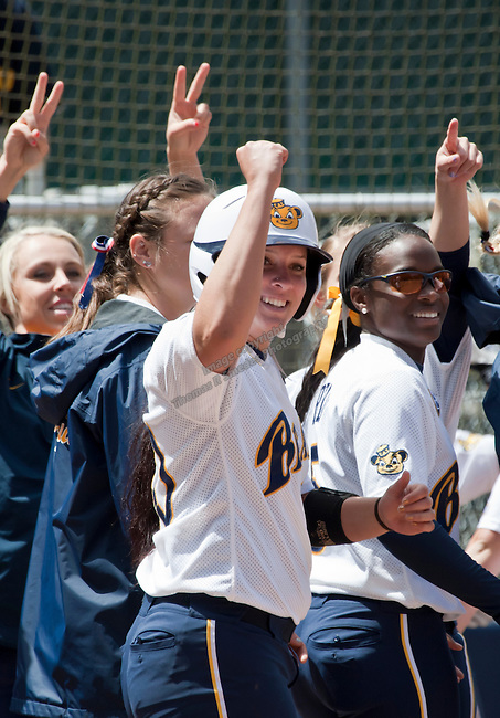 April 15, 2012:  California Bears Valerie Arioto celebrates after hitting a homerun against the Arizona Wildcats during their NCAA softball game played at Levine-Fricke Field on Sunday afternoon in Berkeley, California. Arioto hit two home runs in the California 6-0 victory.