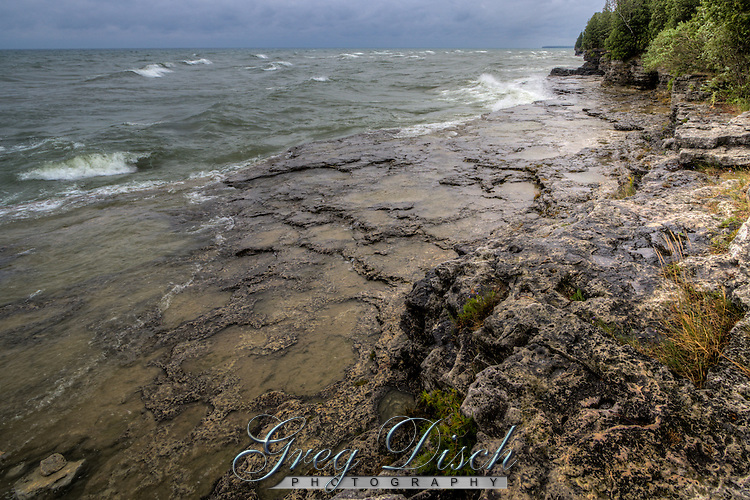 Waves from Lake Michigan breaking at Cave Point County Park in Door County Wisconsin.