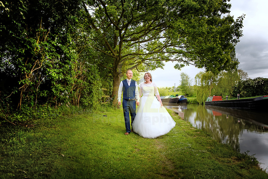 Bride and Groom walking along the Grand Union Canal, Weedon, Northamptonshire.