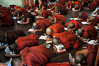 Monks learn prayers in a monastery, Mandalay, Burma November 08.  Monks in this largely Buddhist country have to beg from villagers in order to feed themselves and in this city the government hand-outs stopped after the &quot;saffron revolution&quot; of October 2007.<br />