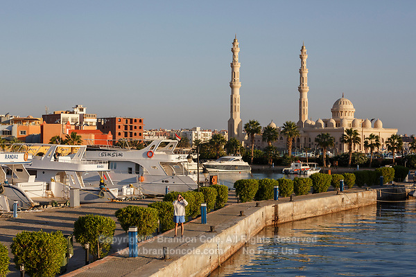 TG40009-D. Numerous scuba diving live-aboard boats which explore the Red Sea are based in Hurghada. The Port Grand Mosque, El Mina Masjid, is in the background. Hurghada, Egypt, Red Sea.<br /> Photo Copyright &copy; Brandon Cole. All rights reserved worldwide.  www.brandoncole.com