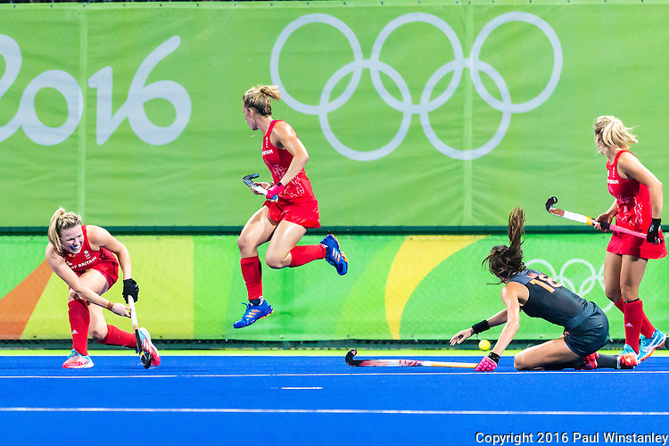 Hollie Webb #20 of Great Britain takes the shot while Susannah Townsend #9 of Great Britain and Naomi van As #18 of Netherlands look on during Netherlands vs Great Britain in the gold medal final at the Rio 2016 Olympics at the Olympic Hockey Centre in Rio de Janeiro, Brazil.