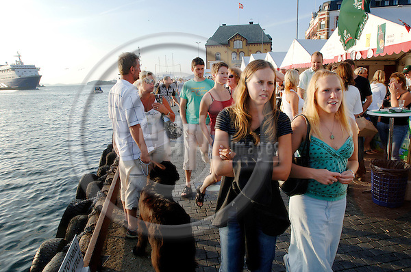 """STAVANGER - NORWAY 3. AUGUST 2006 -- Two girls strolling at the harbour of the Norwegian city Stavanger -- PHOTO: GORM K. GAARE / EUP- IMAGES..This image is delivered according to terms set out in """"Terms - Prices & Terms"""". (Please see www.eup-images.com for more details)"""