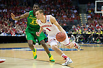 Wisconsin Badgers guard Ben Brust (1) handles the ball during the third-round game in the NCAA college basketball tournament against the Oregon Ducks Saturday, April 22, 2014 in Milwaukee. The Badgers won 85-77. (Photo by David Stluka)