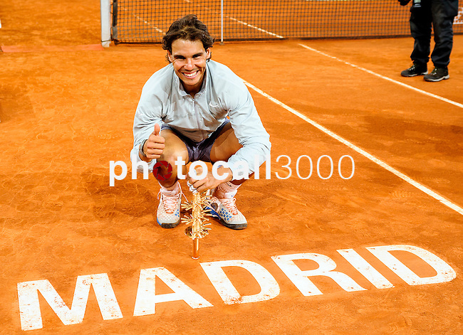 """Spanish tennis player Rafael Nadal celebrates after winning the men's singles final tennis match against Japanese tennis player Kei Nishikori at the Madrid Masters at the """"Caja Magica"""" sports complex in Madrid on May 11, 2014.<br /> <br /> Photocall3000/Daniel Calleja"""