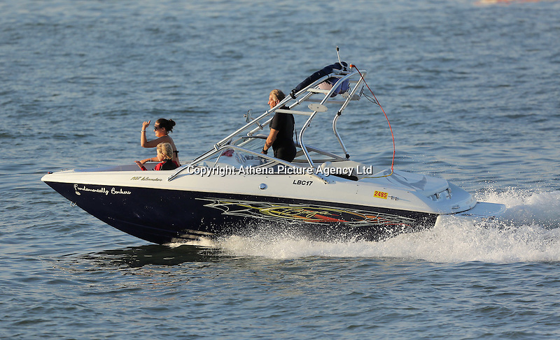 WEATHER PICTURE WALES<br />Pictured: The owner of CK's super markets in his Fundamentally Bonkers speed boat in Mumbles, south Wales UK. Tuesday 16 August 2016<br />Re: High temperatures and sunshine experienced in most of the UK.