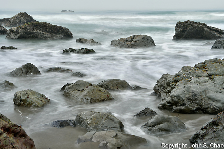 Abstract view of incoming tide flowing among beach rocks at Hidden Beach, Redwood National Park, California