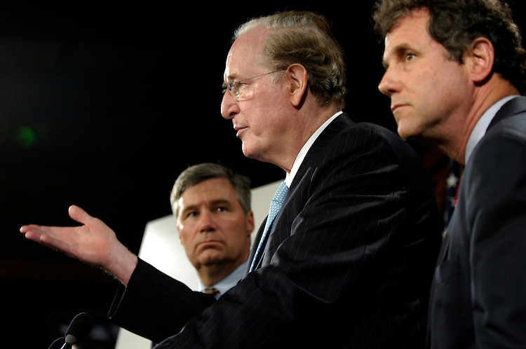 "Chairman John ""Jay"" Rockefeller (center) answers questions alongside Sen. Sherrod Brown (right) and Sheldon Whitehouse (left) after a news conference to ""call on Republican leadership to support meaningful health insurance reform"" in the Senate Radio/TV gallery. Wednesday, August 5, 2009"