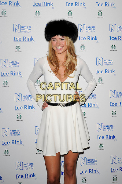 Kimberly Garner.attending the launch of the Natural History Museum Ice Rink at Natural History Museum in London, England, UK, November 1st, 2012..half length russian fur hat white dress belt hands on hips fake tan tanned v neck  .CAP/MAR.© Martin Harris/Capital Pictures.
