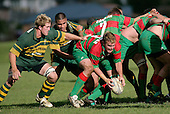 D. Olsen is put under pressure by J. Maher & D. Crighton. Counties Manukau Premier Club Rugby, Pukekohe v Waiuku  played at the Colin Lawrie field, on the 3rd of 2006.Pukekohe won 36 - 14