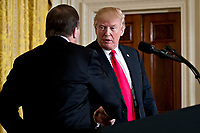 U.S. President Donald Trump, right, shakes hands with Stefan Lofven, Sweden's prime minister, during a news conference in the East Room of the White House in Washington, D.C., U.S., on Tuesday, March 6, 2018. Trump and Lofven are looking to focus on trade and investment between the two countries and ways to achieve shared defense goals. <br /> CAP/MPI/RS<br /> &copy;RS/MPI/Capital Pictures