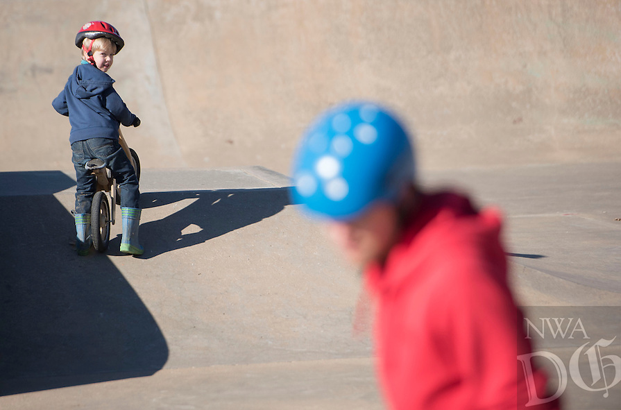 NWA Democrat-Gazette/J.T. WAMPLER Lee Shew, 5, keeps his eyes on his dad Woody Shew of Fayetteville Sunday Jan. 3, 2016 at the Walker Park Skate Park in Fayetteville. According to the National Weather Service there will be mostly sunny skies early this week with a chance of precipitation Thursday.