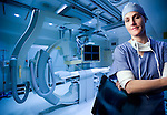 A female doctor in the operating room shot for healthcare annual report; hospital photography