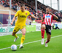 Fleetwood Town's Paul Coutts vies for possession with Lincoln City's Jorge Grant<br /> <br /> Photographer Chris Vaughan/CameraSport<br /> <br /> The EFL Sky Bet League One - Lincoln City v Fleetwood Town - Saturday 31st August 2019 - Sincil Bank - Lincoln<br /> <br /> World Copyright © 2019 CameraSport. All rights reserved. 43 Linden Ave. Countesthorpe. Leicester. England. LE8 5PG - Tel: +44 (0) 116 277 4147 - admin@camerasport.com - www.camerasport.com