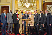 From left to right: Austin Trout, former junior middleweight world boxing champion; Phil Davis, former All American Wrestler & Bellator MMA fighter; Herschel Walker, NFL great & former MMA Fighter; Larry Holmes, boxing legend; United States Senator John McCain (Republican of Arizona); Dr. Charles Bernick, M.D., M.P.H., associate medical director of Cleveland Clinic Lou Ruvo Center For Brain Health; Scott Coker, Bellator MMA President; Paulie Malignaggi, former welterweight boxing world champion; and Kevin Kay, Spike-TV President; pose for a group photo following a press conference to show support of professional fighters study at Cleveland Clinic Lou Ruvo Center for Brain Health on April 26, 2016 in the Russell Senate Building in Washington, DC. remarks at a press conference to discuss the observational study on the brain health of active and retired professional fighters on Capitol Hill in Washington, DC on Tuesday, April 26, 2016.  The study, led by researchers from the Cleveland Clinic, is  designed to better identify, prevent and treat Chronic Traumatic Encephalopathy (CTE.)<br /> Credit: Ron Sachs / CNP