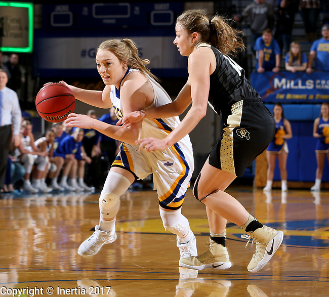 BROOKINGS, SD - MARCH 19:  Madison Guebert #11 from South Dakota State tries to drive past Kennedy Leonard #14 from Colorado during their second round WNIT game at Frost Arena March 19, 2017 in Brookings, South Dakota. (Photo by Dave Eggen/Inertia)