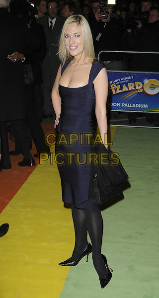 "IMOGEN LLOYD WEBBER .At  ""The Wizard Of Oz"" Press Night, London Palladium, London, England, UK, March 1st 2011..full length navy blue dress hand on hip bandage bodycon cleavage herve leger black shoes tights .CAP/CAN.©Can Nguyen/Capital Pictures."