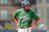 Right fielder Franklin Guzman (10) of the Greenville Drive in a game against the Asheville Tourists on Sunday, July 20, 2014, at Fluor Field at the West End in Greenville, South Carolina. Asheville won game one of a doubleheader, 3-1. (Tom Priddy/Four Seam Images)